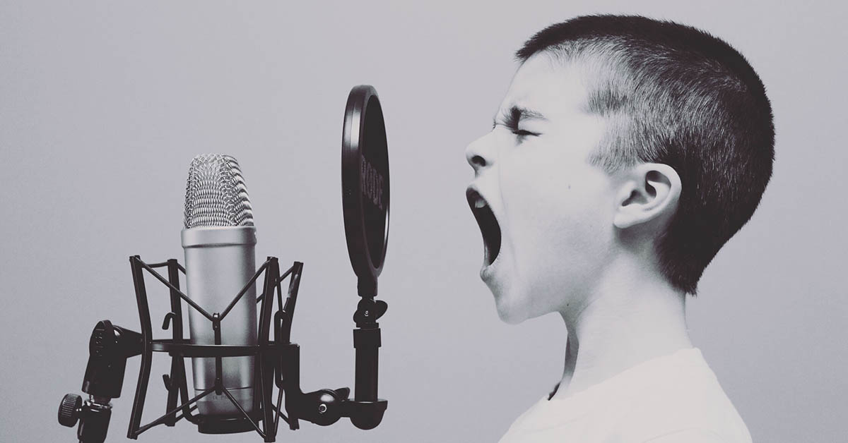girl shouting into a microphone