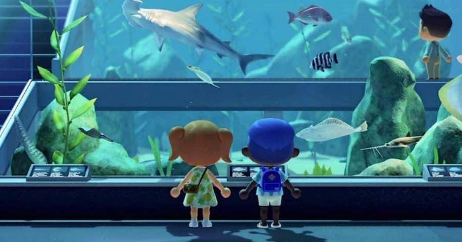 two virtual characters look at virtual aquarium